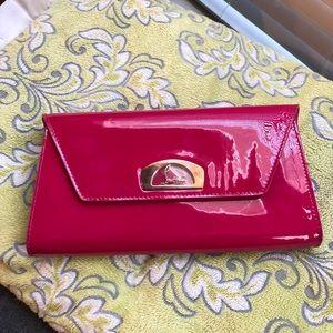Christian Louboutin fuchsia pink clutch or purse.